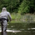 fly fishing tips - man fly fishing in a stream