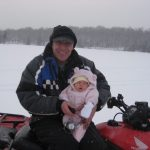 At 6 weeks old Lexi went on her first ice fishing trip with her grandpa and had a great time!
