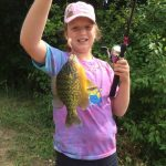 Livia, 10, with her sunfish caught at Shades Mills conservation area