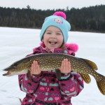 Rebecca Schison with her very first ice fishing catch, and what a catch it is!