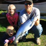 """Andrew Paisley of Nipigon submitted this photo of his daughter Alanna after she caught this 10-lb salmon in Nipigon Bay. """"She reeled it in herself on a lure she picked out. She was so proud of herself."""""""