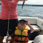 Stacey Nadeau helps son Camden with his first perch on Rice Lake.
