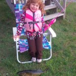 Mckenzie, 4, used her pink Barbie pole with a bobber and worm catch her very first walleye. She did it all on her own and Daddy helped net it.