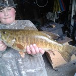 "Garrison Miller, 11, of Blyth landed this 20 3/4"" five-pound small mouth bass with a girth of 13 1/4"" while fishing with his grandfather Jim Keller in the Maitland River outside Belgrave."