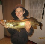 """Brennen Moore, 8, snagged this 25"""" walleye out trolling one night"""