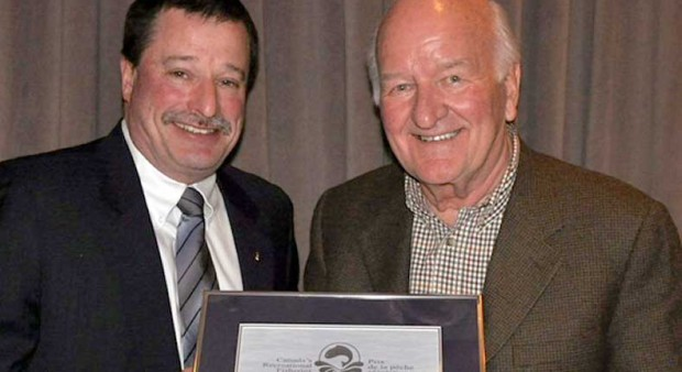 Fisheries and Oceans Canada Regional Director General Dave Burden (left) presents Walter Oster with a 2013 Recreational Fisheries Award.
