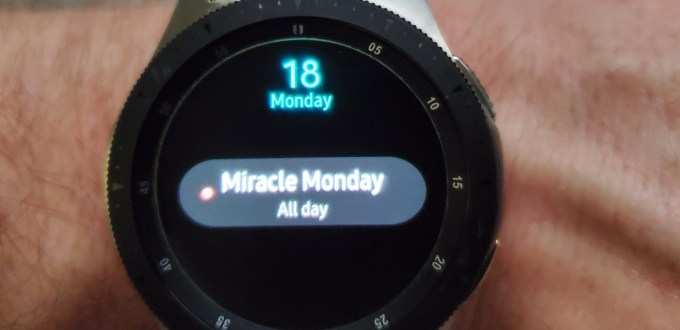 Image of a Samsung Smart Watch showing the date May 18, with the text Miracle Monday All Day