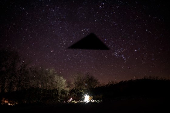 Depiction of triangle UFO at night. (Credit: OpenMinds.tv)
