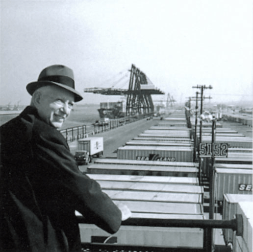 source: Wikipedia Malcolm_McLean_at_railing,_Port_Newark,_1957