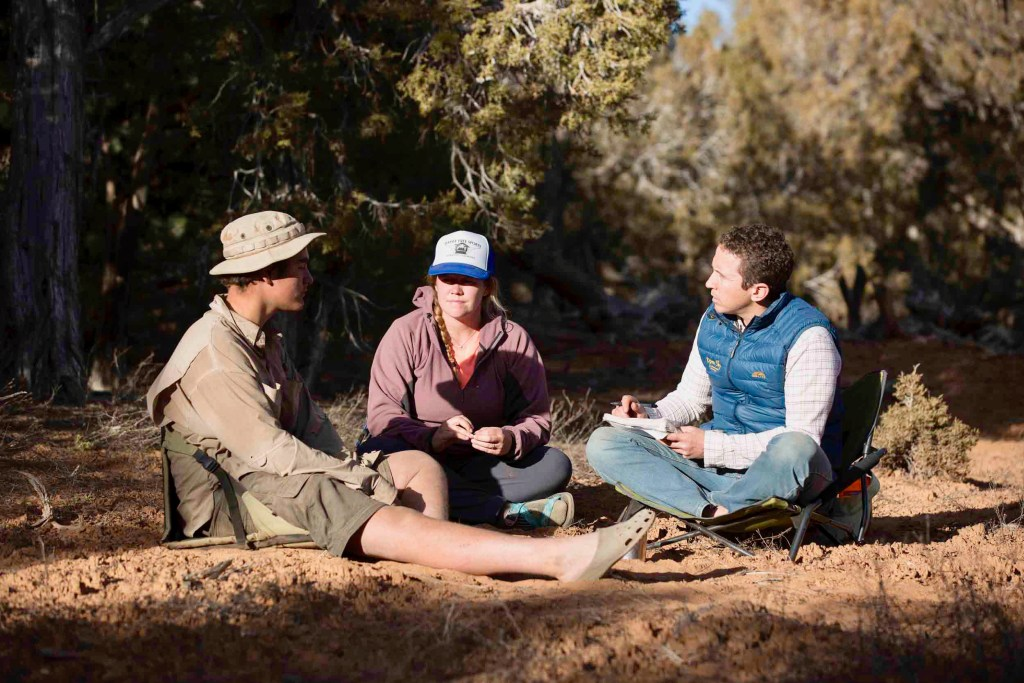 Senior clinical therapist Jonathan Mitchell speaks with an open Sky Wilderness Therapy student and guide.