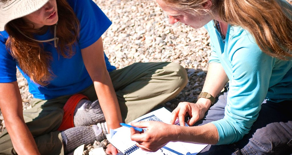 A young adult student at Open Sky Wilderness Therapy works on their Student Pathway with a guide.