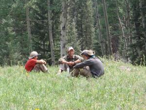 Therapy session in the woods at Open Sky Wilderness Therapy.