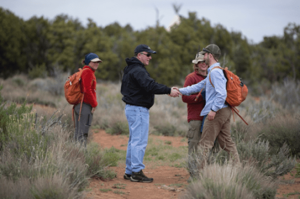 Parents and staff shake hands at Open Sky Wilderness Therapy