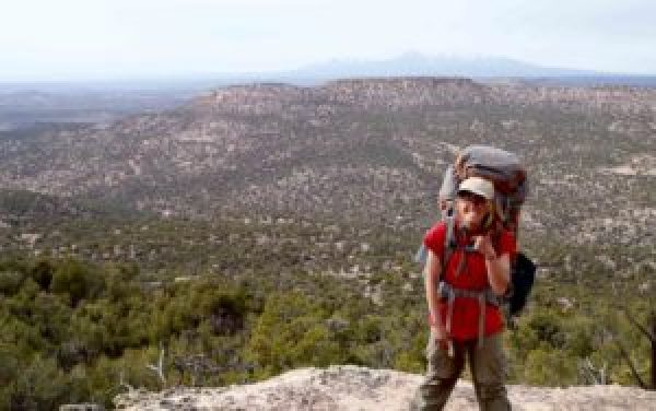 Young adult student gives thumbs up on expedition in Utah at Open Sky Wilderness Therapy