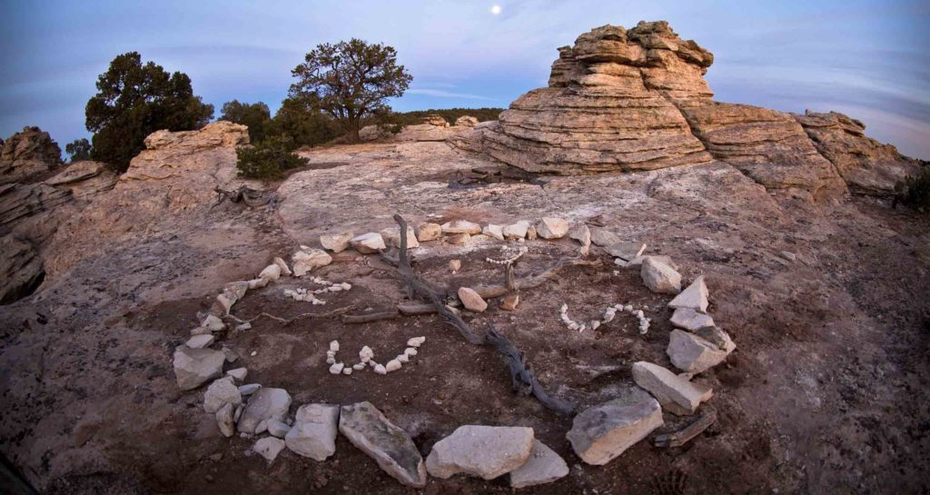 Alt-text: An arrangement of rocks on a plateau created by Open Sky Wilderness Therapy students.