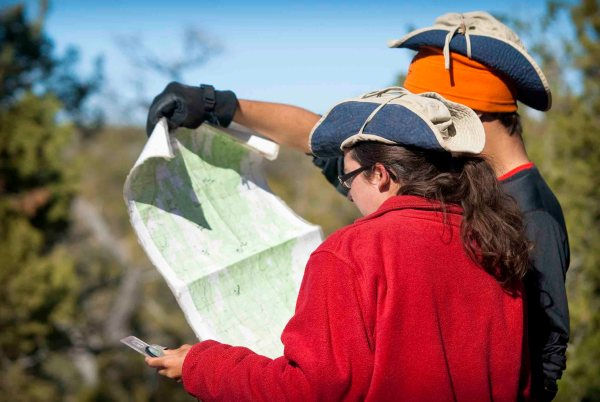 Academics at Open Sky are experiential and dynamic. Here, students learn to read a map to navigate a hike.