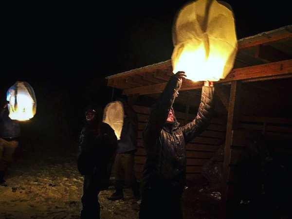 Students release lanterns into the sky on New Year's Eve.