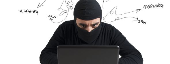 Concept of Hacker at work with Laptop_18917887_l
