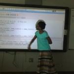 Kid explaining sort algorithms to class.