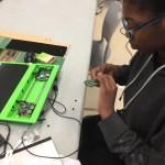 Kid installing prototyping board