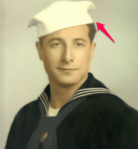 navy sailor with his hat tilted to the side