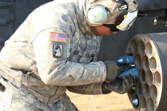 an AH-64D Armament / Electrical /Avionics Repairer at work