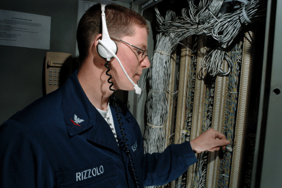an Interior Communications Electrician at work