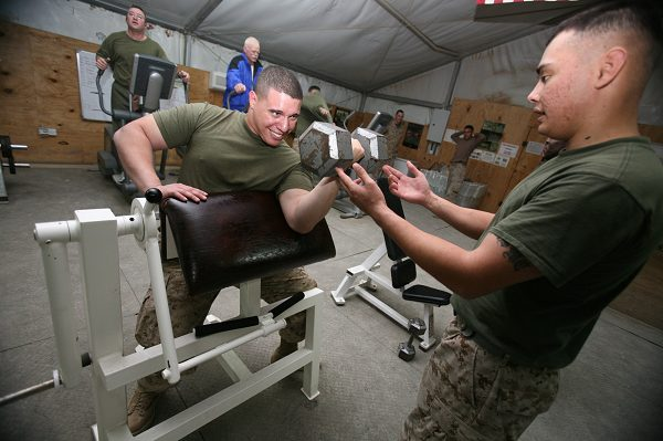 Maintenance Management Specialist working out while on deployment