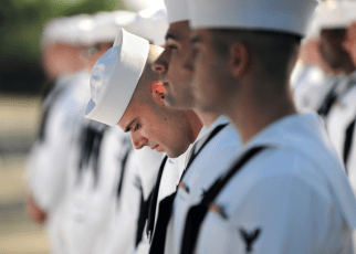 Navy CTN does a final inspection of uniform