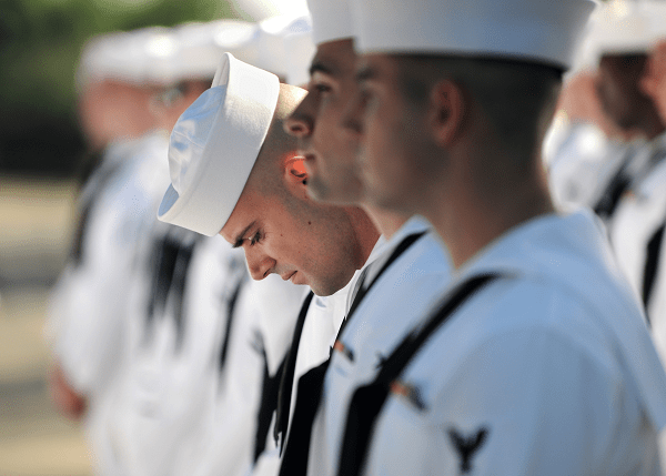 Navy CTN does a final inspection of uniform