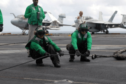 green shirt aircraft carrier