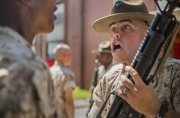 Drill Instructor inspects and disciplines recruits