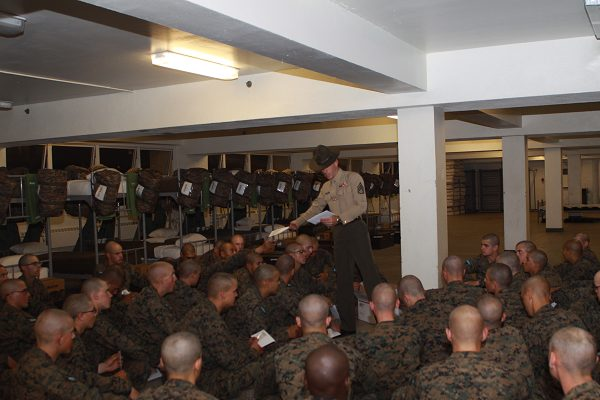 Drill instructor passes out boot camp letters to Marines