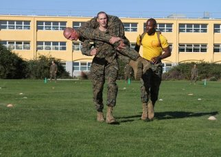 recruits uses the fireman's carry technique during Marine CFT