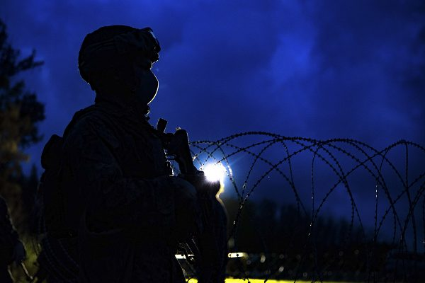 A U.S. Marine stands watch according the Marine General Orders