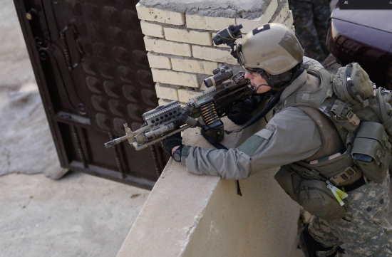 an army ranger with a MK 46 machine gun - army rangers weapons