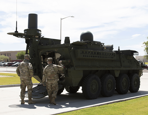17 E MOS st Armored Division Electronic Warfare specialist take a look at the Army's newest EW system, the Stryker-mounted Tactical Electronic Warfare System (TEWS)