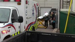 EMTs Extricate Woman from Abortion Facility into Back Alley Strewn with Trash Dumpsters