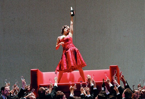 Violetta (Anna Netrebko) lives a life of wild partying and debauchery at the start of the opera