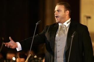 Maltese tenor Joseph Calleja sings during his concert in the main square of Malta's ancient capital city Mdina July 7, 2007. REUTERS/Darrin Zammit Lupi
