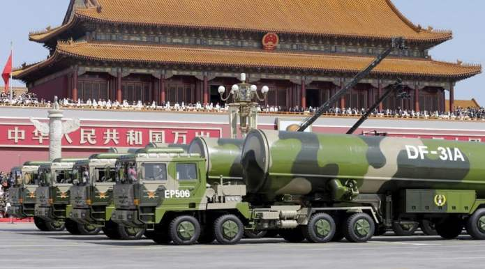 Military vehicles carrying DF-31A long-range missiles drive past the Tiananmen Gate during a military parade to mark the 70th anniversary of the end of World War Two, in Beijing, China, September 3, 2015. REUTERS/Jason Lee - RTX1QTYV
