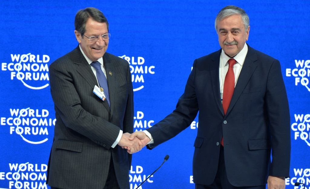 DAVOS, SWITZERLAND - JANUARY 21: Greek Cypriot leader Nicos Anastasiades (L) shakes hands with President of Northern Cyprus Mustafa Akinci (R) during the World Economic Forum (WEF) in Davos, Switzerland on January 21, 2016. ( Dursun Aydemir - AA )