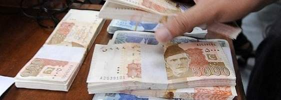 Pakistan rupee falls the most in nine years