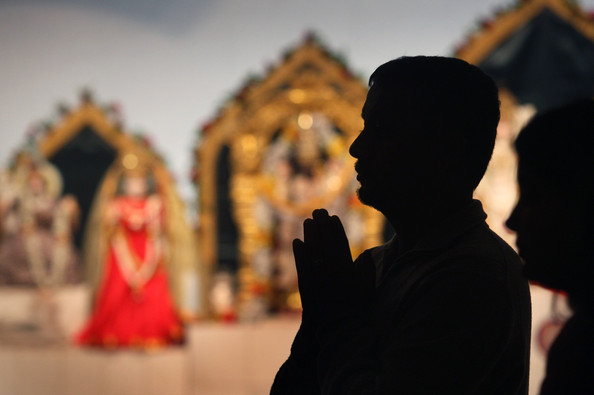 An unidentified Hindu man praying