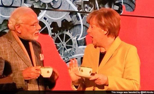 pm-modi-angela-merkel-tea_650x400_41428912722