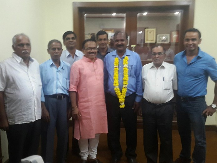 Kishore Shet in less milkier times with Goa CM, shortly after his victory