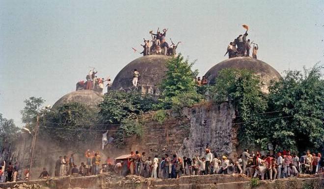 Babri mosque being demolished
