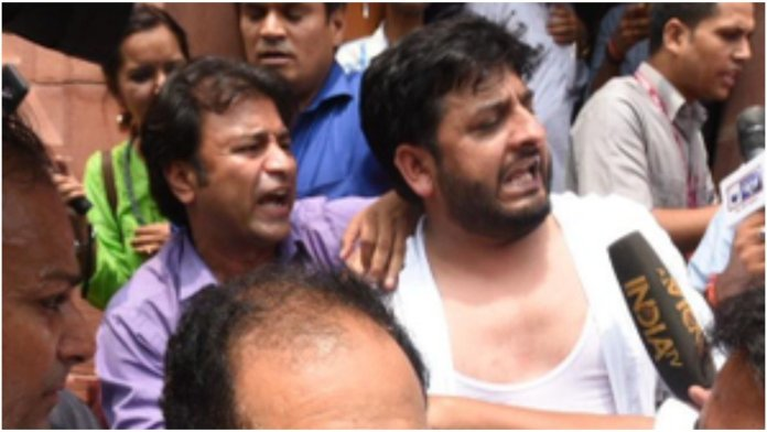 PDP MP marshalled out of the Lok Sabha after they try to tear the copies of Indian constitution