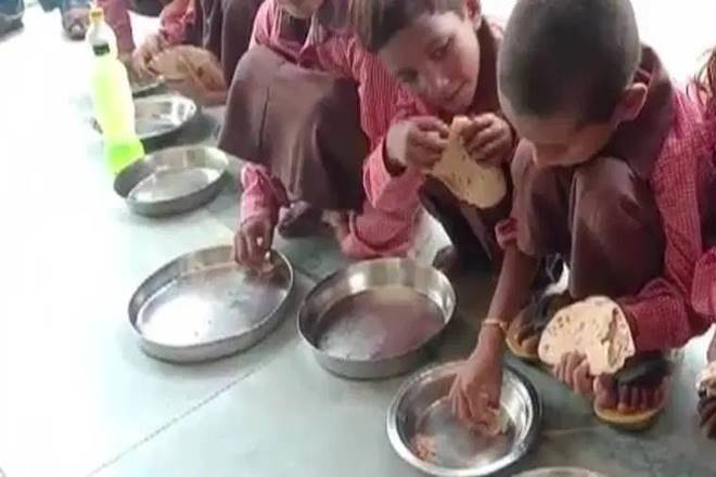 Salt and roti being served to children in Siyur govt school in Mirzapur, UP