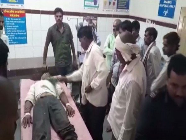 A snakebite victim in a district hospital in Madhya Pradesh is seen being treated with witchcraft